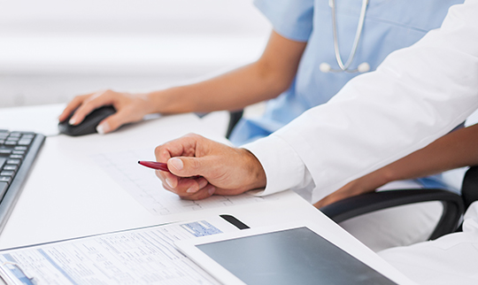 Medical staff viewing reports