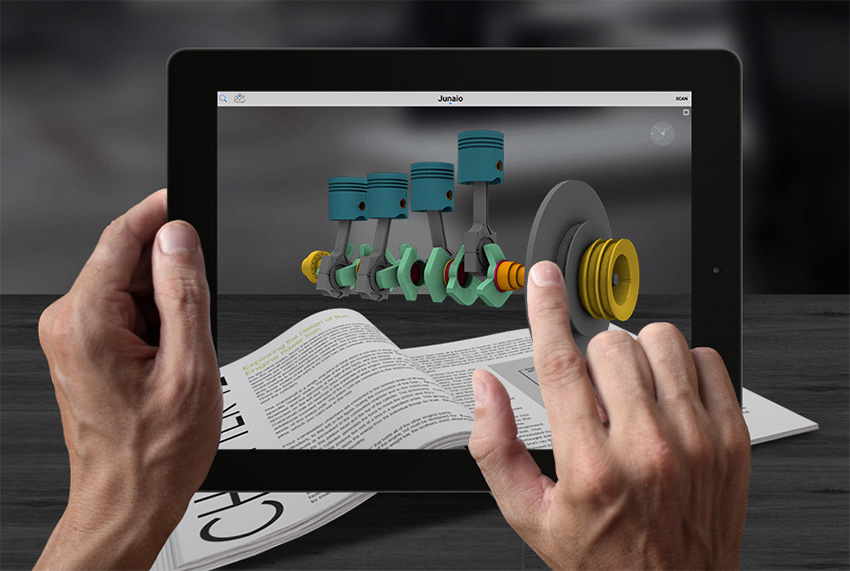 Tablet displaying an augmented reality model of pistons