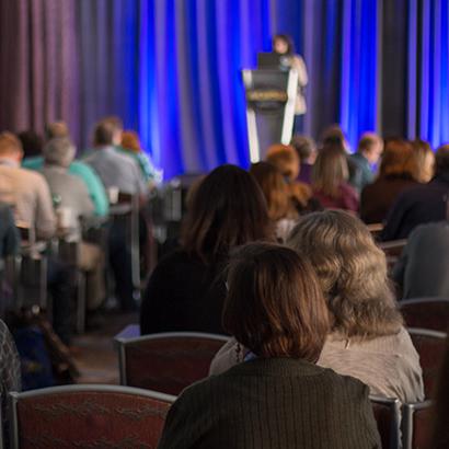 Attendees at a MadWorld presentation
